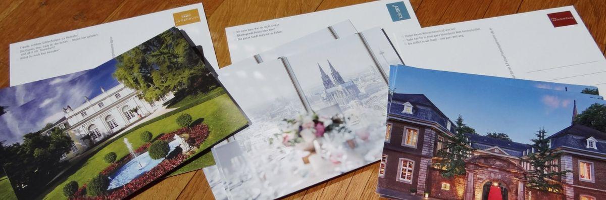 Postkarten mit Bildern von Redoute, KölnSKY und Wolkenburg