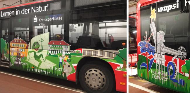 Im Foto ist der mit Illustrationen und Logos beklebte Bus zu sehen